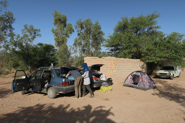 Our campsite at the busiest waterhole in the desert. © Laura Tiemann
