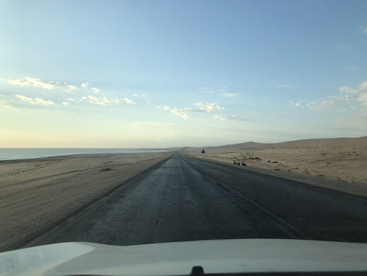 The road towards Swakopmund with the Atlantic Ocean on the left and the Namib Desert on the right.
