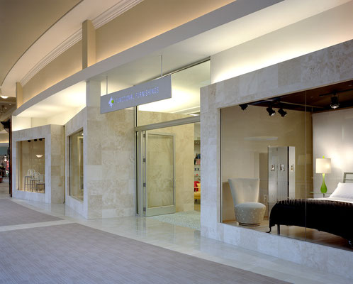 "Storefront ""cubes"" for display - breaking the traditional mall frontage concept"