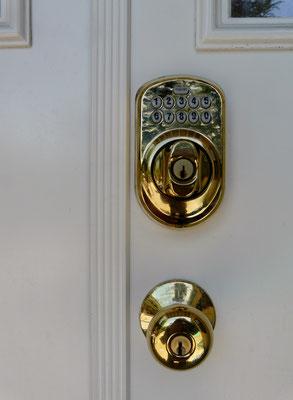 Schlage keypad deadbolt lock installation completed exterior view photo