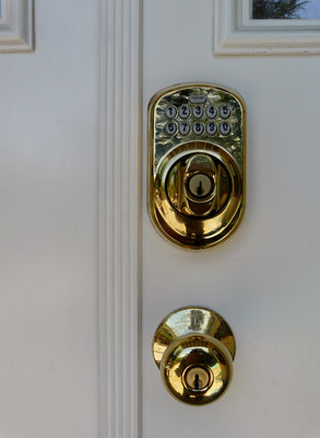 Schlage keypad deadbolt lock installation completed exterior view photo
