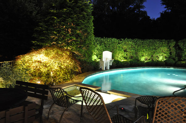 """Landscape lighting around the pool, allows one to enjoy their own personal """"resort-like"""" oasis."""