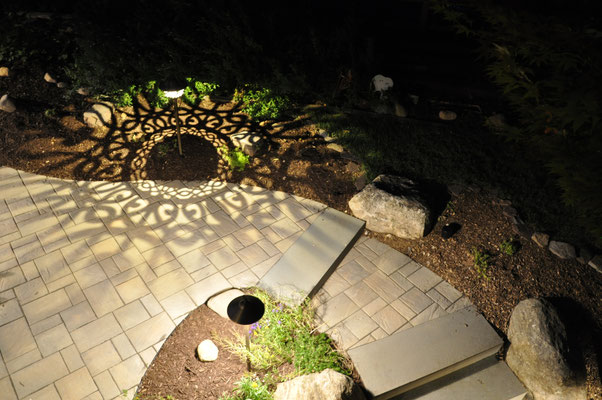This landing (between the driveway, yard, and deck steps) is the perfect spot for this elegant fixture and it's mesmerizing shadow patterns. Montvale, NJ