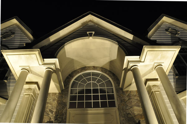 This portico is beautifully illuminated with spotlights aimed onto each column. The light reflected back provides an inviting ambiance to the front entrance. Upper Saddle River, NJ