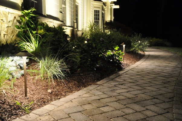 The wide broad hat of this particular path light creates an even distribution of soft light along the long pathway, eliminating the bright circles and dark spots often seen on long pathways. Bergen County, Northern NJ