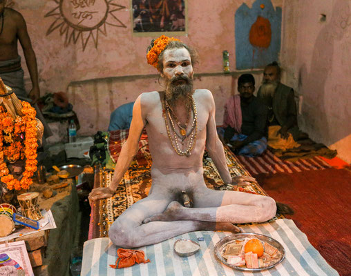 A sadhu sitting at the ghats of Varanasi, India