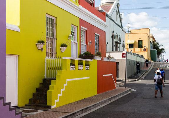 People walking on a street in Bo-Kaap, Capetown, South Africa