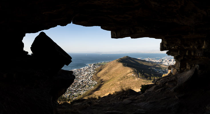 View of Signal Hill in Capetown out of a Lion's Head cave, South Africa