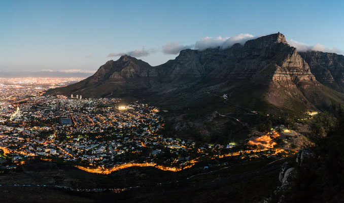 Table Mountain and Capetown city bowl seen from Lion's Head during dusk