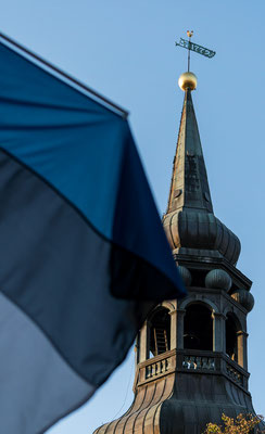 Church tower with Estonian flag