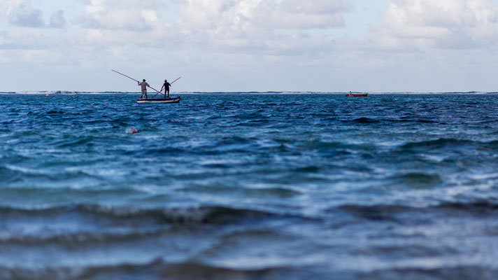 Two fishermen in a boat on Mauritius