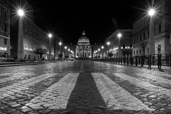 A black and white crosswalk in front of St. Peter's Basilica