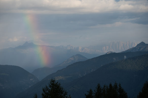 Rainbow over Southern Tyrol mountains seen from Sterzing, Italy