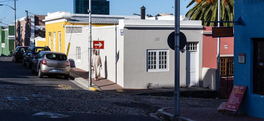 Man walking on a street in Bo-Kaap, Capetown, South Africa