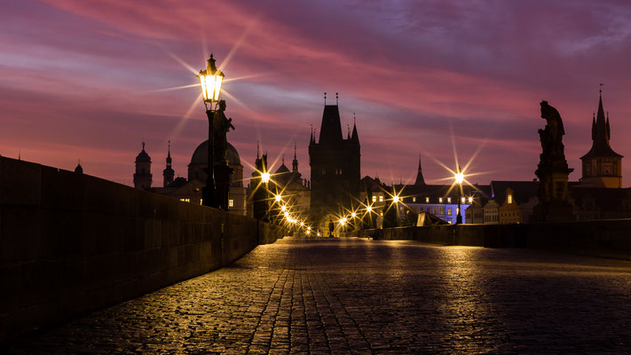 Red sky over Charles bridge in Prague