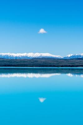Mirrored clouds over Lake Tekapo, New Zealand