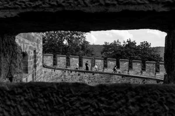 Looking through a stone opening at a castle