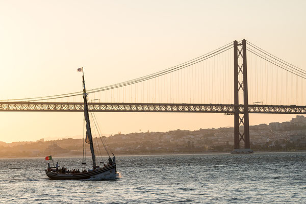 Ponte de 25 Abril over Tejo in Lisbon at sunset