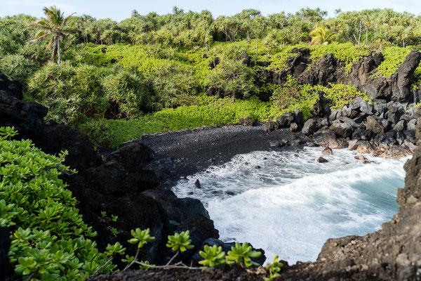 Black sand beach at Waianapanapa State Park on Maui, Hawaii