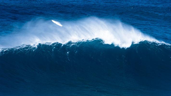 Surf board flying over huge Peak wave, Jaws Hawai'i