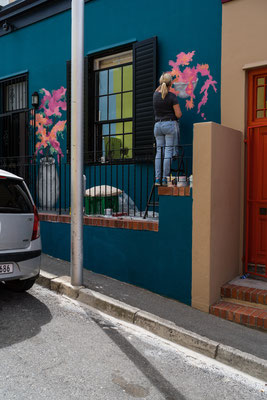 Woman painted a wall in Bo-Kaap, Capetown, South Africa