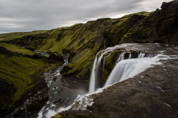 On top of Fagrifoss waterfall in Iceland