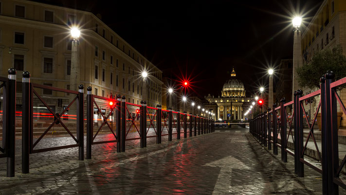 Some red light streaks at night towards St. Peter's Basilica
