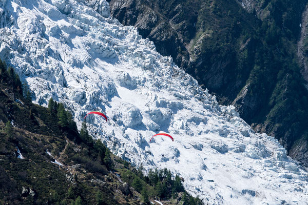 Two paragliders descending at one of the Mont Blanc glaciers