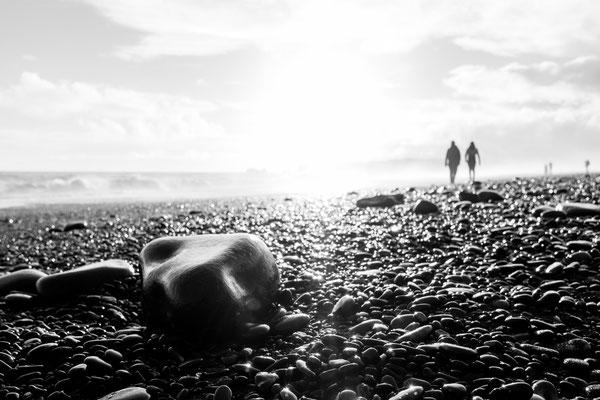 Pebbles at the Reynisfjara black beach in Iceland