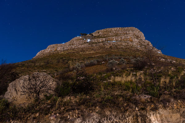 Lion's Head with light torches of hikers