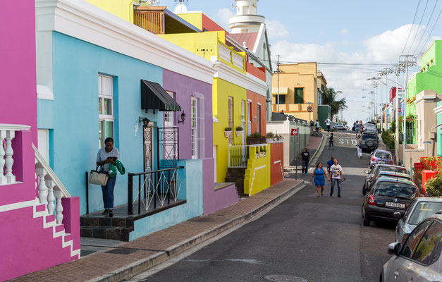 Woman leaving her house in Bo-Kaap, Capetown, South Africa