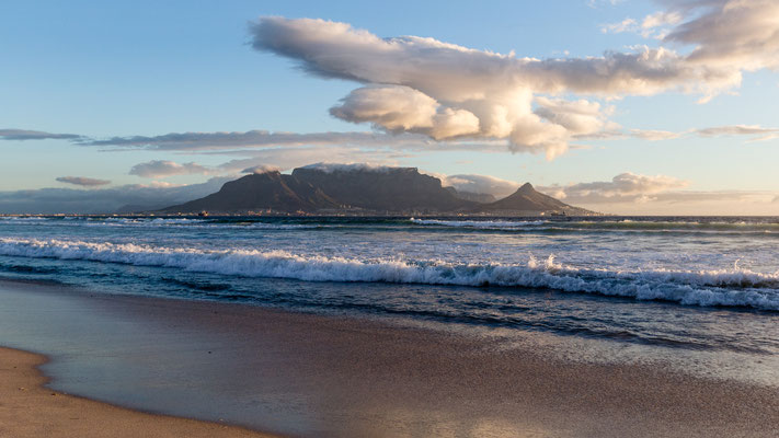 Looking at Table Mountain and the Capetown silhouette from Bloubergstrand