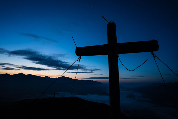 Summit cross of Roßkopf, Sterzing, Italy, before sunrise