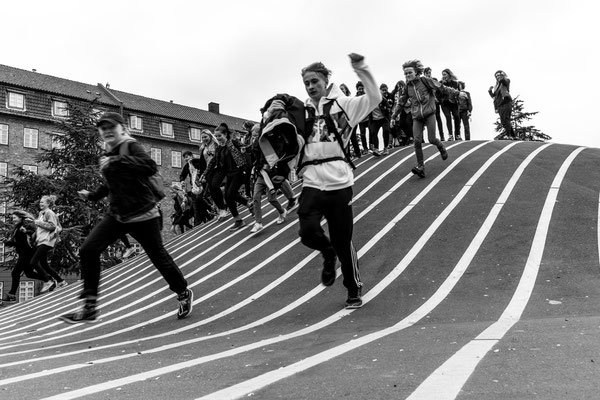 Kids running at Superkilen in Copenhagen's district Nørrebro