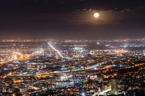 Close up of Capetown city bowl with full moon rising