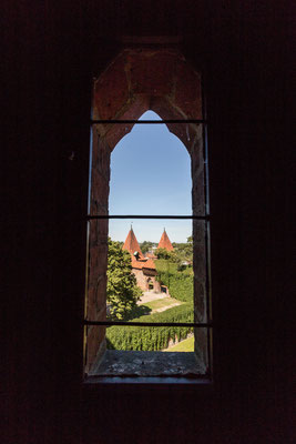Using an old castle window to frame parts of the castle in Poland