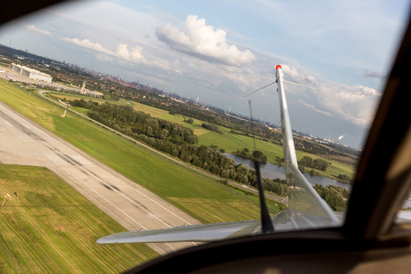 Aerial of Airbus Finkenwerder Airport off Cessna rear