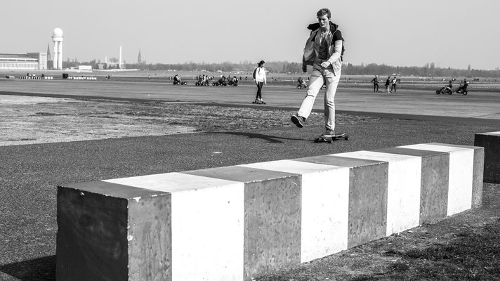Skateboarder on old Berlin airfield Tempelhof