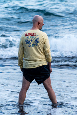 Man standing at black beach at Waiʻānapanapa State Park, Maui, Hawai'i Island, USA