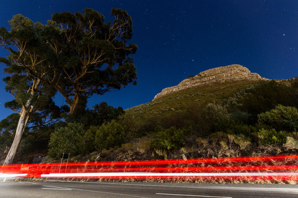 Lion's Head at night with hight streaks of cars