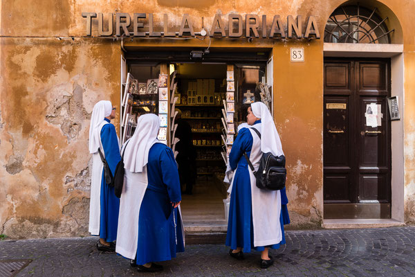 Three nuns at shop near Vatican