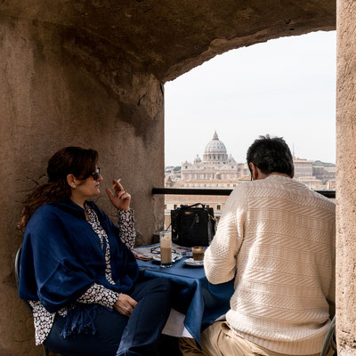 Enjoying a break on top of Castle Sant'Angelo looking at St. Peter's Basilica