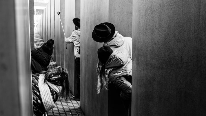 Youngsters taking a selfie at Holocaust Mahnmal in Berlin