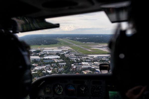 Aerial of Hamburg Airport Fuhlsbüttel off Cessna cockpit