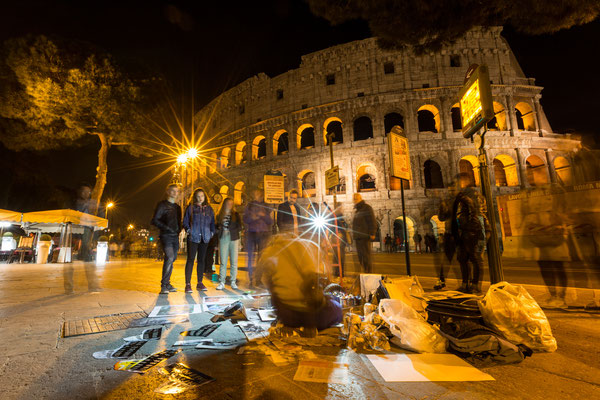 Artists painting the Colosseum even at night