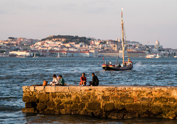 Sailing boats on Tejo opposite Lisbon at sunset
