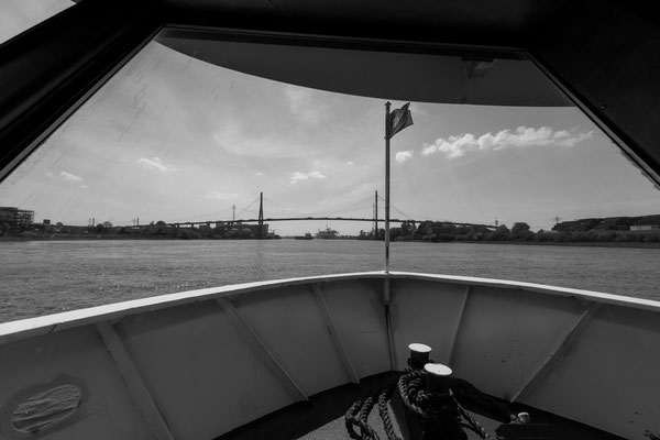 Using the bow of a ferry to frame the Köhlbrandbrücke in Hamburg