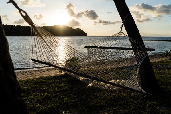 Hammock at sunrise at Naukacuvu Island, Yasawa Islands, Fiji