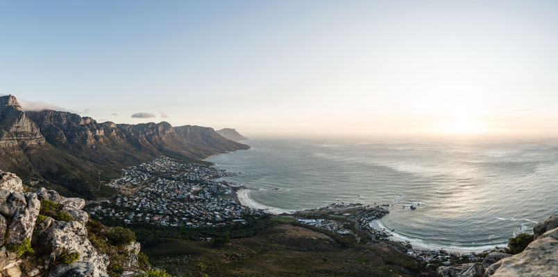 Viewing Camps Bay Beach and Clifton Beach seen from Lion's Head during sunset