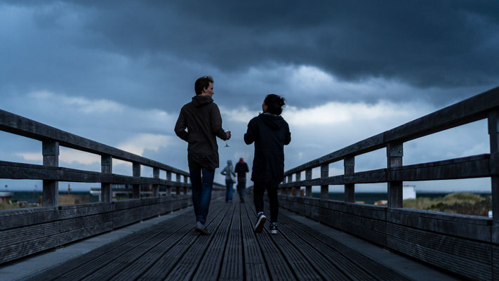 Two couples on Seebrücke in Heiligendamm during storm